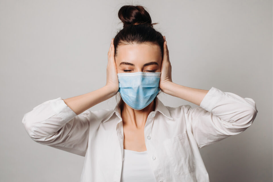 Student in mask overwhelmed